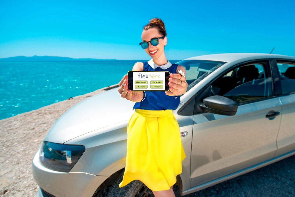 woman-holding-iphone-with-flexperx-app-in-front-of-car